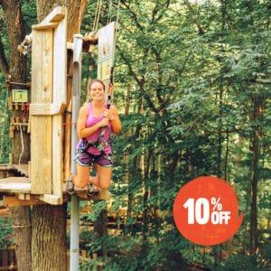 Women leaps off a Tarzan Swing at a Go Ape Treetop Adventure